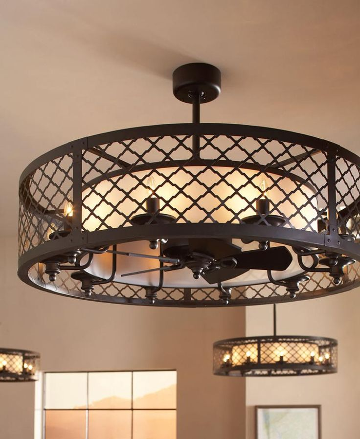 The unique design of the brighton court ceiling fan is classified as a fandelier a decorative exterior shade covering a small gentle fan within