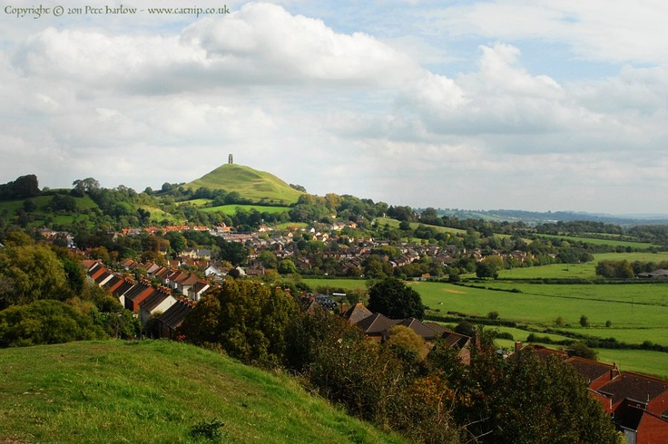 On top of Wearyall Hill  L L  ooking east from Wearyall Hill, - near the site of the Holy Thorn - the Tor rises above the rooftops of the town.