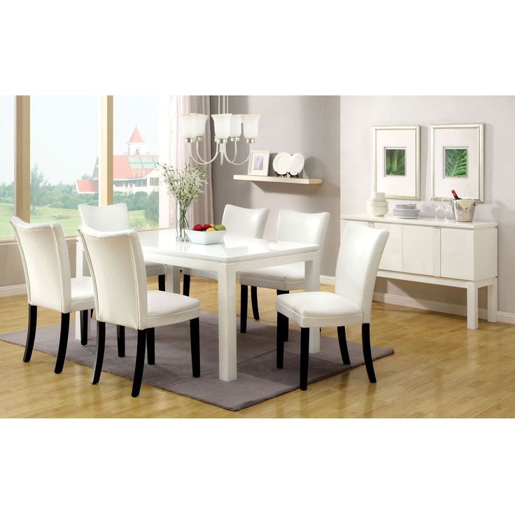 Keep your home's decor up to date with this contemporary lacquered dining table that is available in either a black or a white color option. Constructed from solid wood and wood veneers, this chic piece will add beauty and style to your dining room.