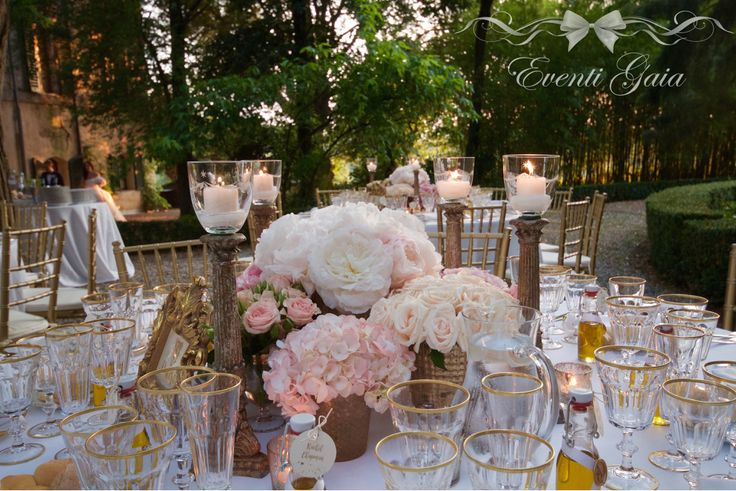 Wedding table set-up flowers candles gold chiavarina gold candelabra Gold & Pink Wedding hydrangea, blush pink roses, pink peonies and olive oil as placecards #weddingitaly #weddingplanner #weddingplanneritaly #luxurywedding #tuscanwedding #weddings #gold #pink #peonies #roses #flowers #placecards