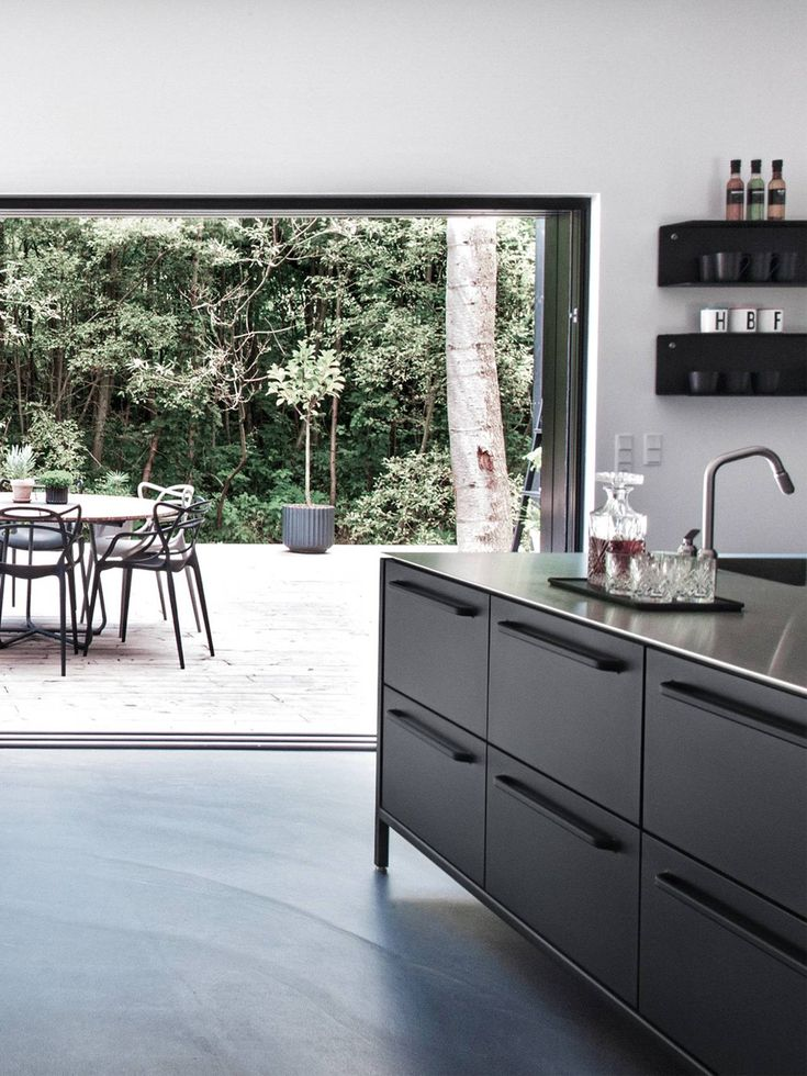 Vipp black kitchen island with stainless steel table top - credit ET hus