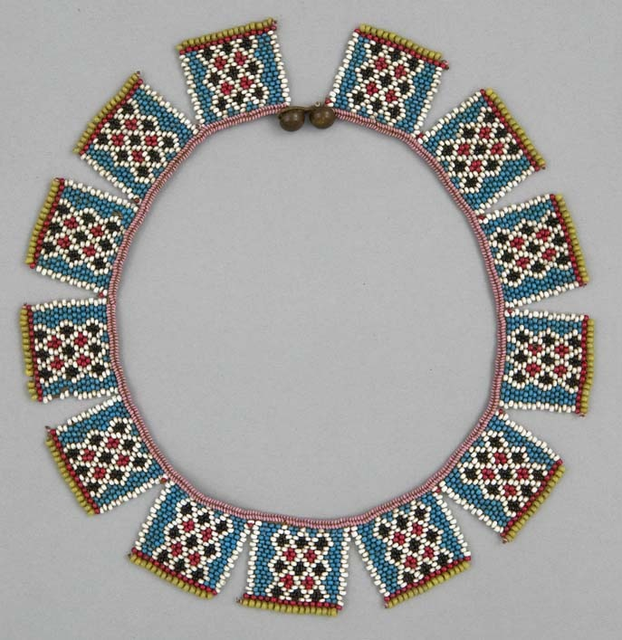 Africa | Necklace ~ iqabane ~ from the Zulu people of South Africa | ca. 1870 - 1930 | Glass beads, brass buttons and plant fiber.