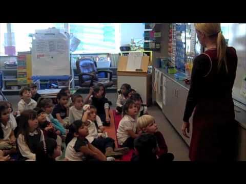 """This video shows a kindergarten class using the Whole Brain Teaching techniques of mirroring, echoing, """"teach,"""" reciting the five rules, and using the scoreboard."""