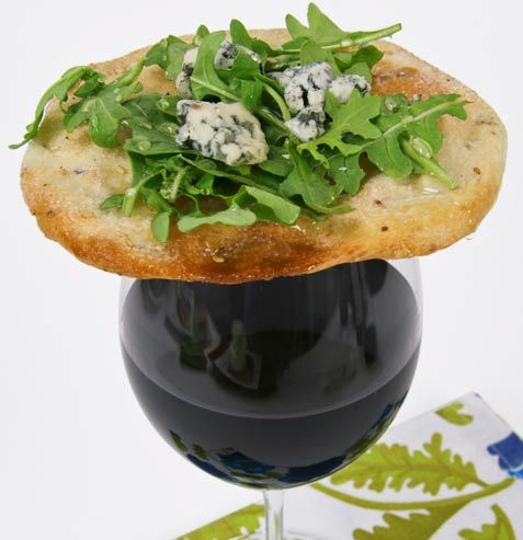 Spanish Tapas: Mitica Torta de Aceite Sweet Flatbread can double as a cracker, or a plate! We topped the flatbread with arugula, Mitica Orange Blossom Honey and some hearty pieces of Valdeón Blue cheese.