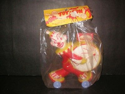 Vintage 1950s 60s toy clown bank made by Tico Toys....TOY INDUSTRIES CO. INC Providence R.I..This great guy is mint in the original package...never removed.It retains its paper insert in the coin slot