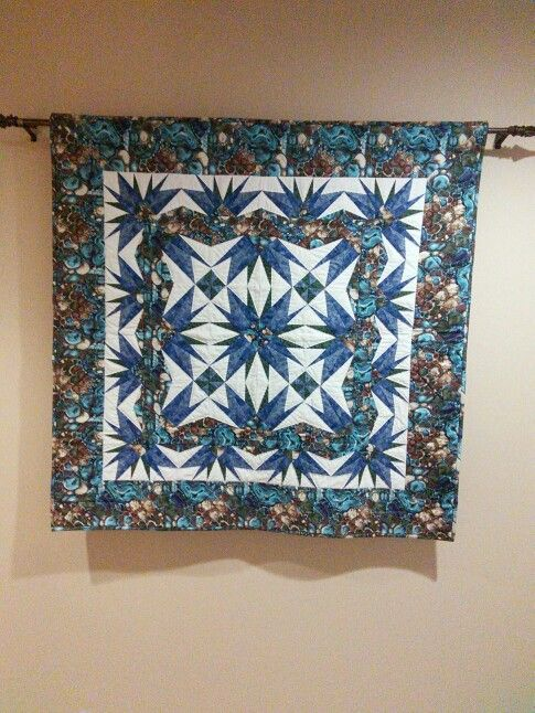 Probably my first paper-pieced quilt made from fabrics bought from the biggest  fabric store i San Diego.