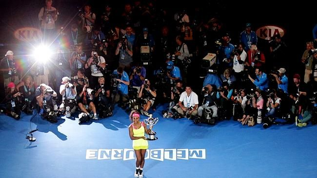Serena Williams poses the trophy after defeating Maria Sharapova in the women's singles final at the Australian Open Picture: AP
