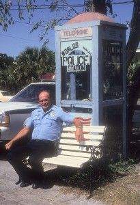 If you've got trouble in Carrabelle, Florida, just dial 3691. That's the number for a blue phone booth on the main drag that is the world's smallest police station. The phone booth is shaded by a shiny berry tree, and there's a park bench in front where policemen can keep an eye on the town of Carrabelle (population 1,800).