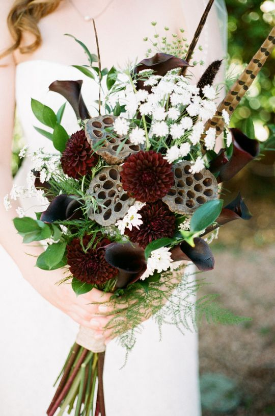 fall wedding inspiration   oxblood + brown bouquet w/ feathers and texture