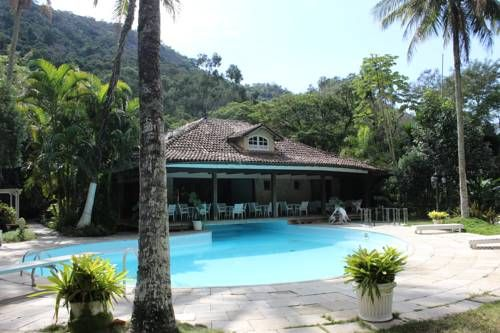 S�tio das Pedras Rio de Janeiro Situated in Rio de Janeiro in the Rio de Janeiro State Region, 3.6 km from Barra Olympic Park, S?tio das Pedras boasts an outdoor pool and views of the garden. Free private parking is available on site.  There is a shared lounge at the property.