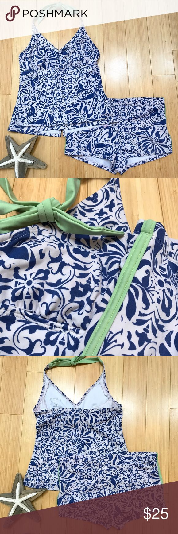 ATHLETA tankini, M. Cute blue and white tankini by Athleta. The bottoms are a size medium. The top is a category two which fits 36C, 34D, 32DD - I feel it would fit a small or medium. Structurally these are in good condition but they look like they were washed with something pink. The exterior white is light gray-ish pink, and there is a little running on the green tie. Neither is particularly noticeable while you are wearing it, but please be aware. No bra pads present. Super cute and…
