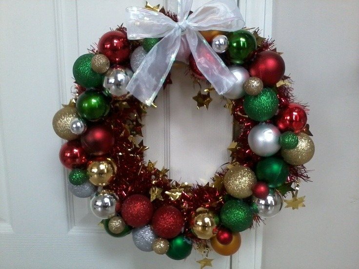 Christmas wreath made out of pipe insulation foam, tinsel ...