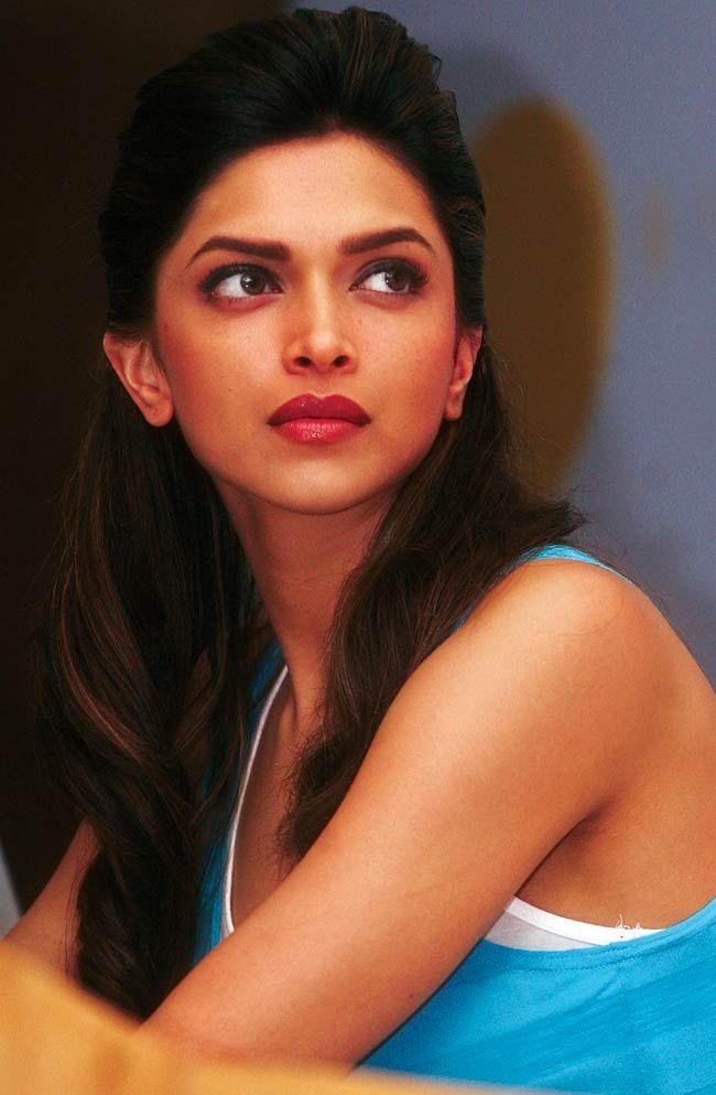 Deepika Padukone looking intense in a blue top. #Bollywood #Fashion #Style #Beauty