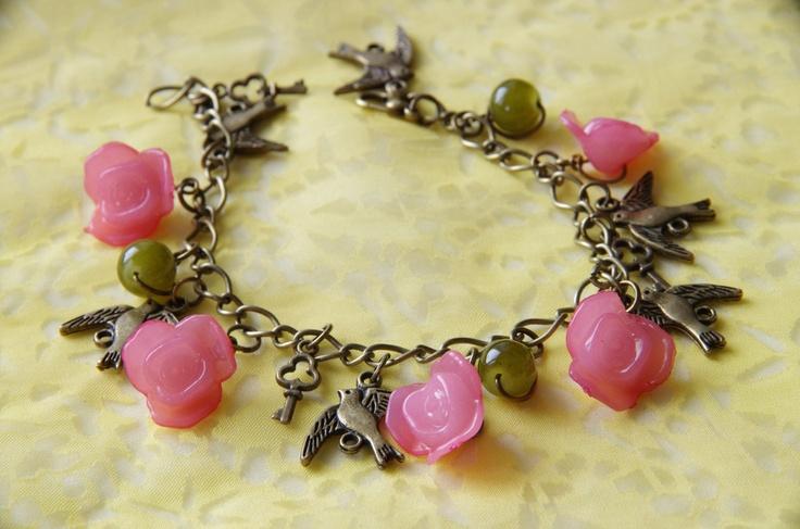Birds and Flowers OOAK Charm Bracelet: Vintage-Inspired Brass and Pink Woodland Wonderland Charm Bracelet with Keys. $22.95, via Etsy.