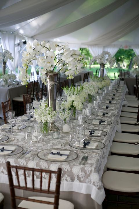 Use texture on your tables - this white lace tablecloth echos the shapes of the white flowers ~ https://www.insideweddings.com/weddings/interfaith-wedding-with-soft-neutral-color-palette-in-cincinnati/742/