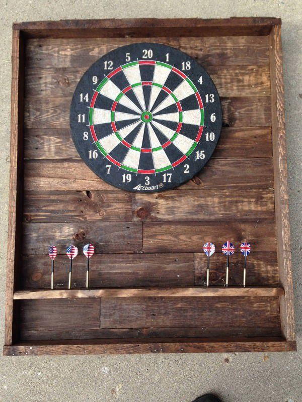 """Simple design for a dart board. 30"""" x 36"""" makes for ample room for missed shots without damaging wall. Used min wax special walnut stain 224. Spent about $20 to make it. All of the wood was pallet wood."""
