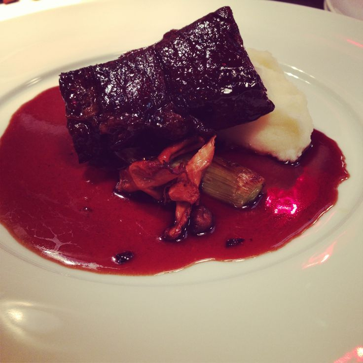 Braised Bison Short Ribs, pomme puree, roasted onion, port reduction