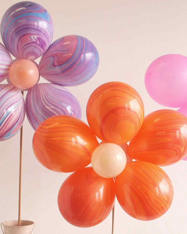Floral Balloon Bouquet | Martha Stewart Living - Skip the traditional floral arrangements and spruce up your event space with bouquets of balloon blooms-on-a-stick that double as fun props for photos.