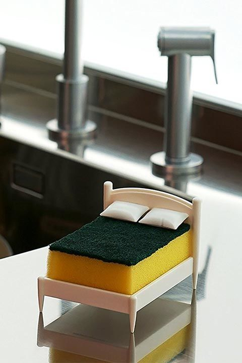 Clean Dreams Kitchen Sponge Holder: This clever OTOTO studio holder isn't just a conversation starter, it's also functional. It features an internal spine that keeps soapy water away from the sponge and helps it dry faster. Click through for more kitchen sink supplies you'll love.