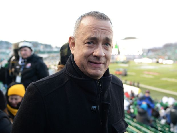 Tom Hanks poses for a photo at the 101st Grey Cup game held at Mosaic Stadium in Regina, Sask. on Sunday Nov. 24, 2013.