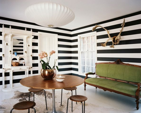 Decor Photo - Horizontally striped walls paired with a green antique settee and a round tulip-style table
