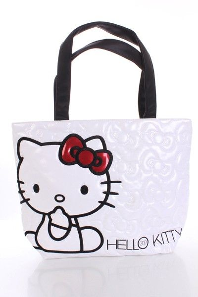 HELLO KITTY WHITE QUILTED WITH BOWS FAUX LEATHER TOTE WITH FAUX LEATHER APPLIWUE AND EMBROIDERED DETAILS. 18 X 14.