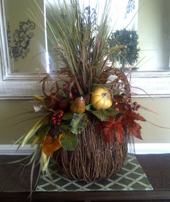 pumpkin floral arrangements | Fall Feather Rustic Pumpkin Floral Arrangement by perpetualposy