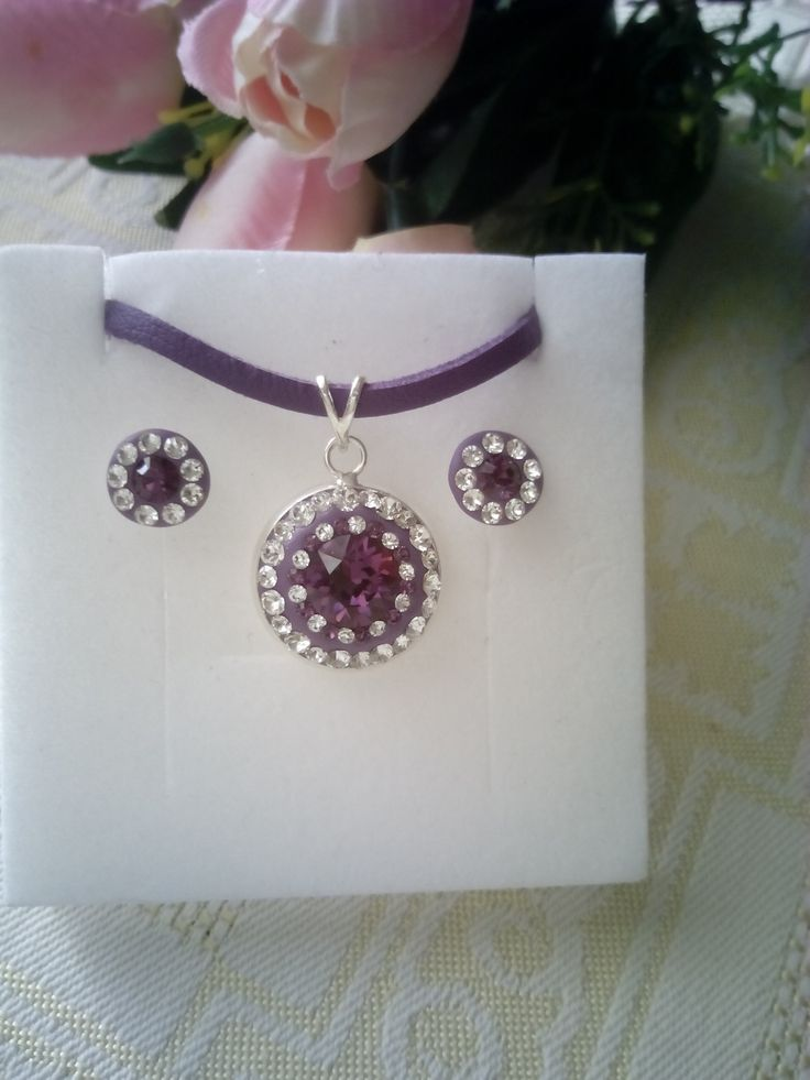 Silver stud earrings and pendant with Swarovski crystals in Ceralun construction.