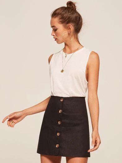 Let your skirt do the talking. This is a mini length, a-line skirt with center front buttons.