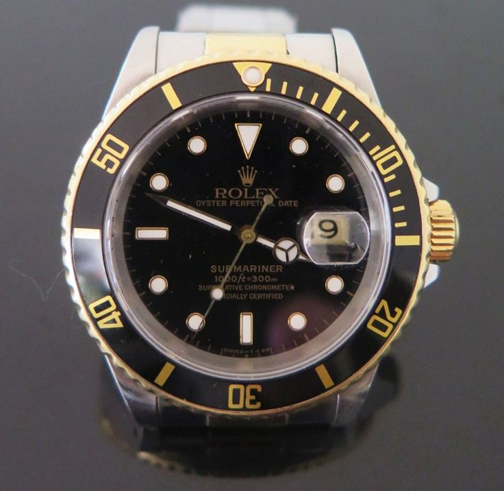 A Rolex Gent's Submariner Perpetual Date Wristwatch in a steel and gold case with a black dial and bezel, running