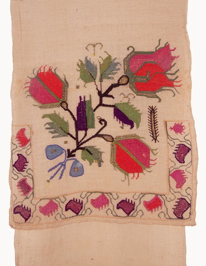 This sash features a bold design of floral motif at each end. The bright pink, green, purple and blue silk embroidery is done in double sided stem stitch wi