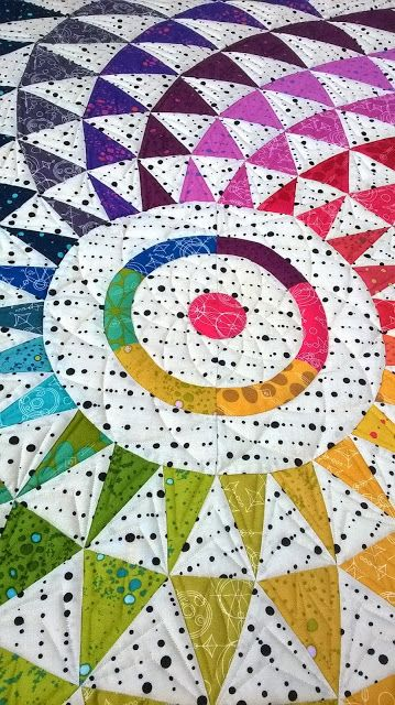 """""""Eclipse."""" It was designed and pieced by Kimberly Bourne of Main Street Market Designs. Quilted by Barbie Mills 