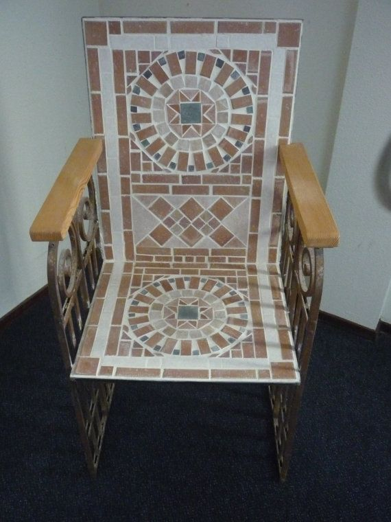 Unique mosaic garden chair, with a wrought iron frame, stone mosaic and wooden arm rests. on Etsy, $387.00