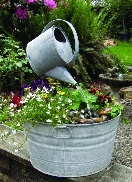Wash Tub Water Feature Watering Can Appears To Be Hanging