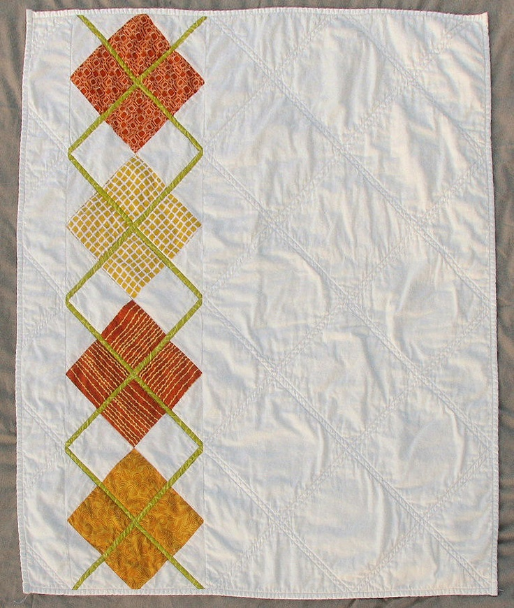 Modern Argyle Quilt  For some reason I like this.  I would probably continue the pattern across though