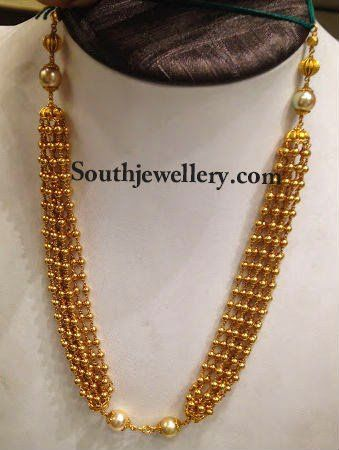Antique multistrand gold beads necklace with south sea pearls.