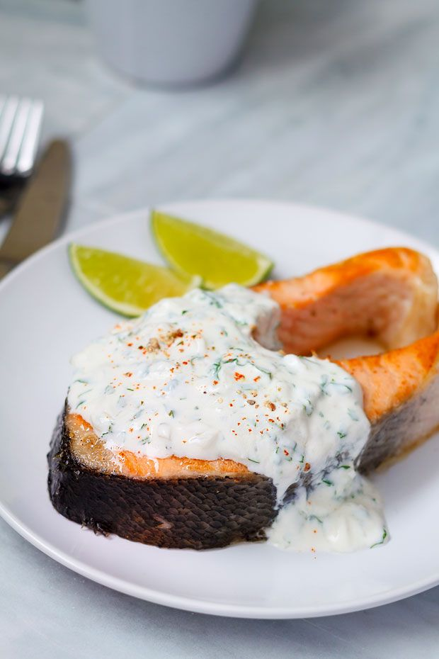 Smothered in a light and flavorful yogurt sauce, this salmon steak in the skillet or on the grill will literally melt in your mouth. The salmon steak recipe is almost impossible to mess up and is q...