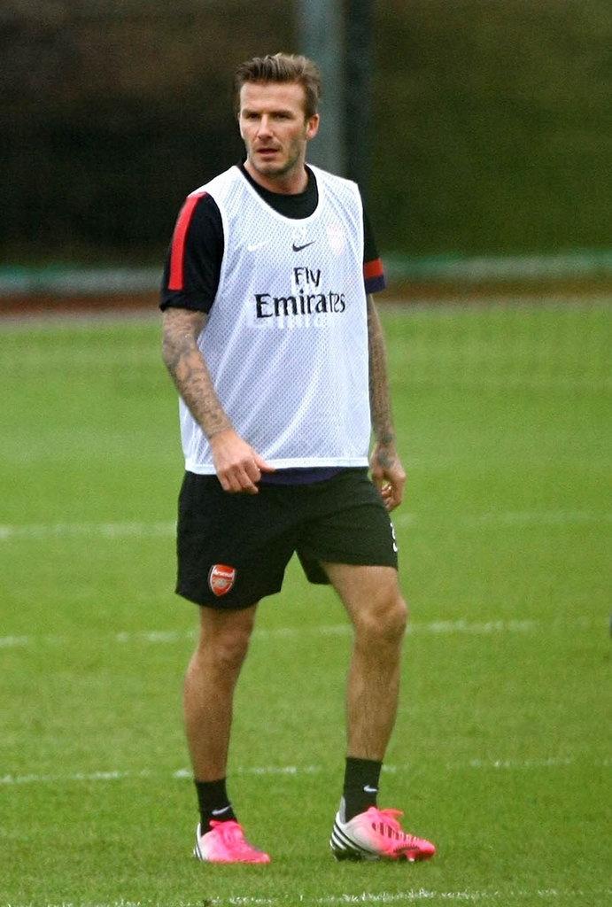 DavidBeckham trained with the Arsenal club on the soccer field.