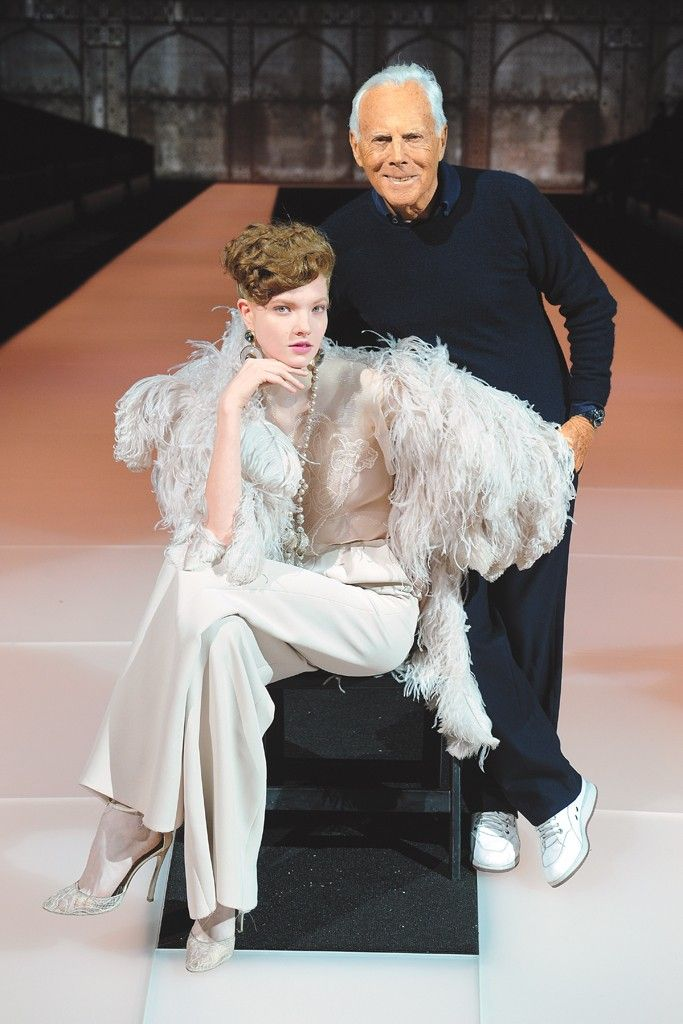 Giorgio Armani with a model wearing a look from the fall Giorgio Armani Privé collection. [Photo by Steve Eichner]