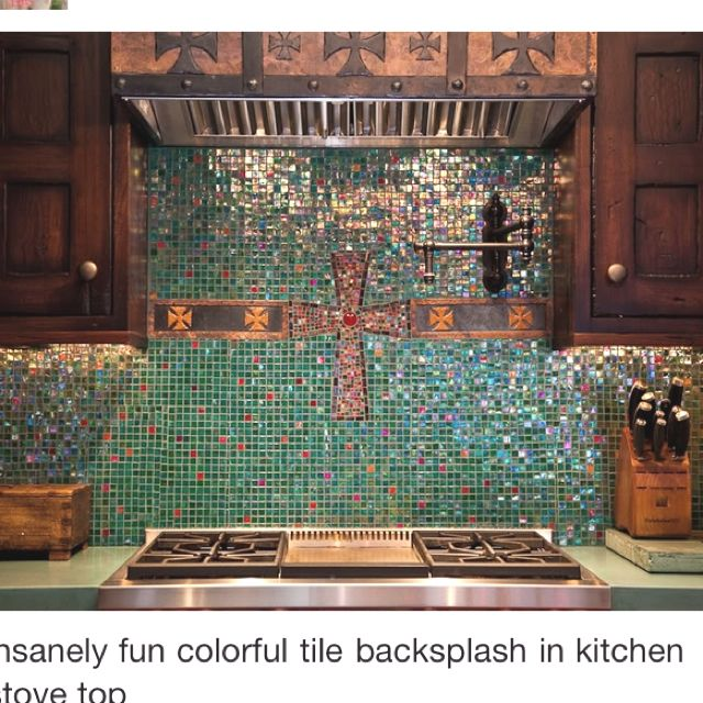 Awesome turquoise western kitchen backsplash! Love the crosses!