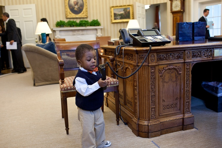 Corbin Fleming,  March of Dimes National Ambassador Lauren Fleming, plays with the President's telephone during his family's visit to the Oval Office. The kid is super cute on his own, but with the phone? when the president isn't looking? adorable!!