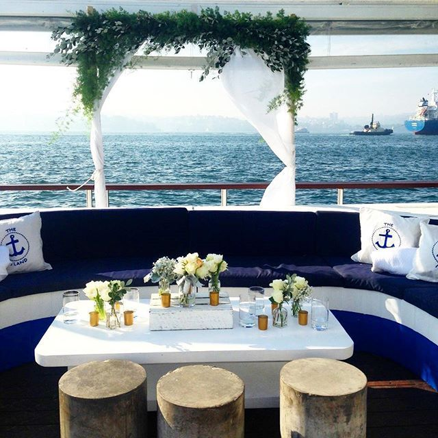 A luscious foliage arch to adorn the bridal party area on this gorgeous boat party wedding.