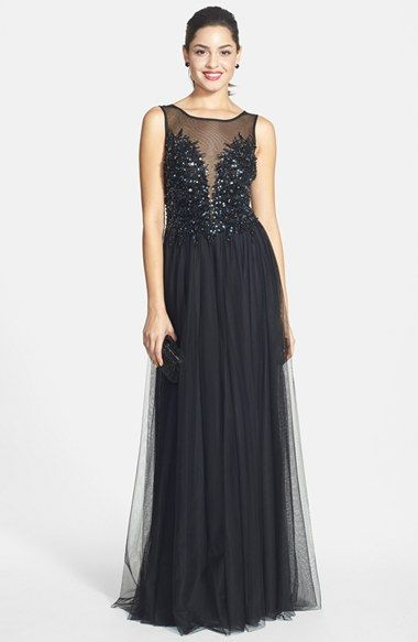 Free shipping and returns on Xscape Embellished Mesh Ball Gown at Nordstrom.com. A plunging illusion-yoke décolleté flanked by twinkling sequined beads dishes out a heavy dose of glamour on this gauzy mesh gown that pools at the full, sweeping skirt. The low-cut back is equally sheer and sparkly.