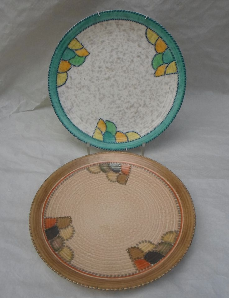 Two 1930s Crown Ducal wall plaques, designed by Charlotte Rhead in the 4015 (green) and 4088 (brown) Patch patterns, each having a tube-lined decoration, printed and tubed marks verso, each 32cm diameter