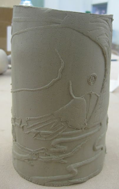 Cassie Stephens: DIY: Embossed ceramic clay...try cut linoleum or hot glue lines over drawing or design. Roll slab over.