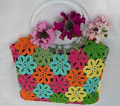 Fun way to use flower motifs ~ pattern { ♥ the clear lucite handles}