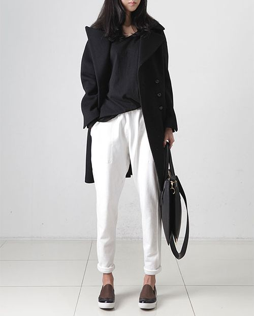 white slouchy pants. slouchy tea. loafer-esque shoes. black slouchy over coat.