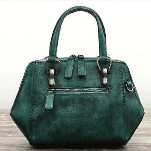 Genuine Leather Handmade Handbag Crossbody Bag | Evergiftz | Camel, Camel Black, Dull Red, Purple, Green Material: Cowhide Measures: 18cm x 31cm x 11cm Slots: 2 large slots, 2 inner pocket slots, 2 inner zipped slots, 1 back pocket slot, 1 front pocket slot #handbags
