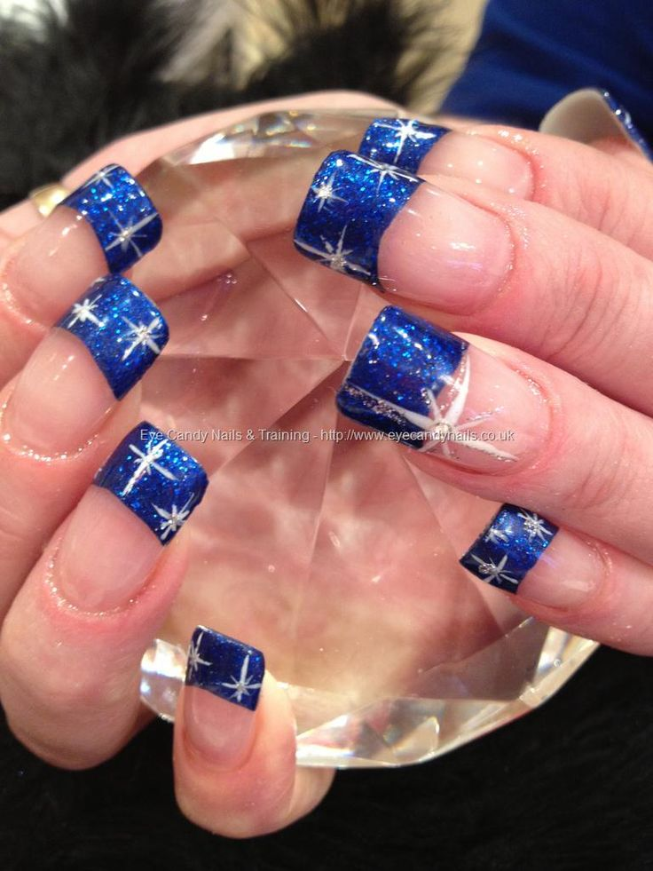 Electric blue polish with white star freehand nail art