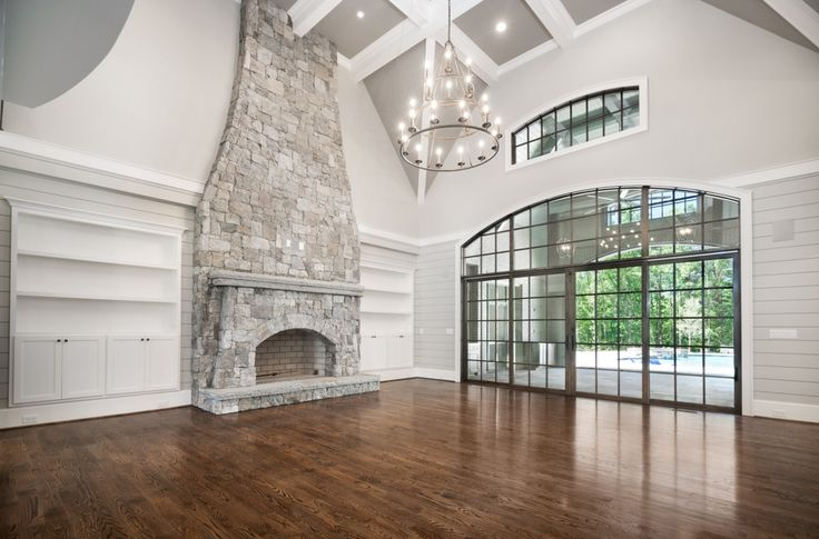 Stacked stone fireplaces allows us to bring comfort and cozyness into decors and spaces that would otherwise feel bland. Living room GOALS! Floor to ceiling stone fireplace ...